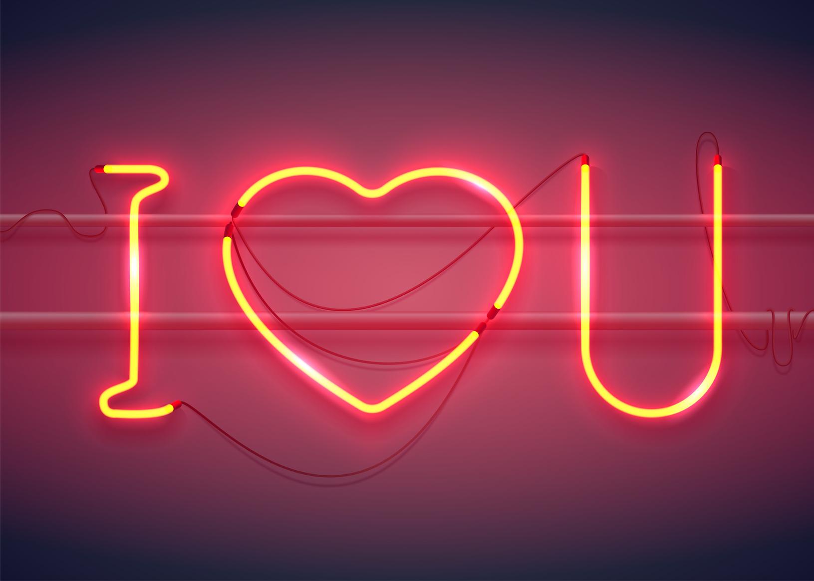 """""""I love you"""" in Leuchtschrift – mit einem Herz als Symbol für """"love""""."""